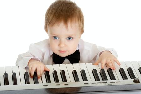 prodigy: adorable child playing electronic piano
