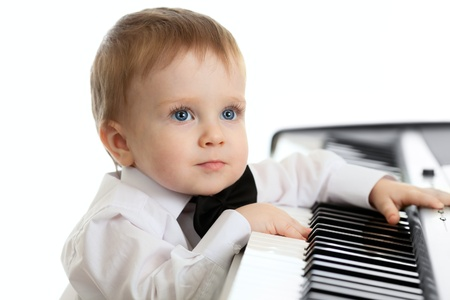 adorable child playing electronic piano Stock Photo - 11589271