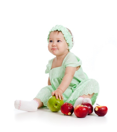 baby girl with healthy food photo