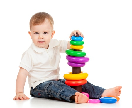 child playing with color pyramidion Stock Photo - 11589297