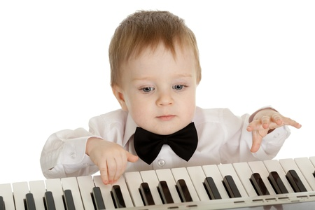 adorable child playing electronic piano Stock Photo - 11591553