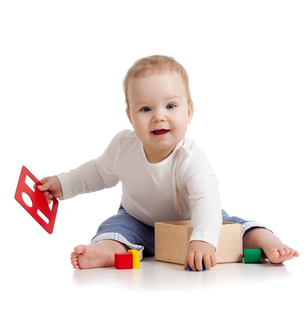 baby girl playing: pretty baby with color educational toy