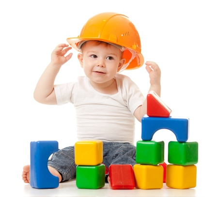 little boy with hard hat and building blocks photo