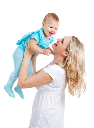 carrying girl: mother holding cute baby over white background