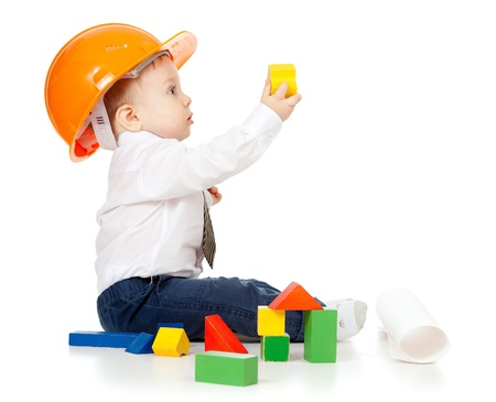 little boy with hard hat and engineering drawing