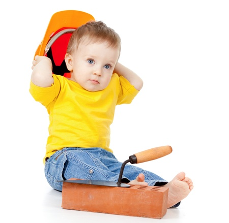 smiling child with hard hat and construction tools photo