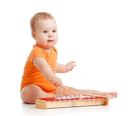 child playing with musical toy Stock Photo - 11850844
