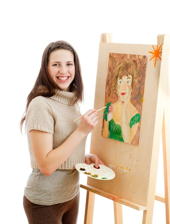 smiling girl painting a picture photo