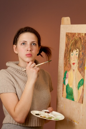 Girl painting a picture photo