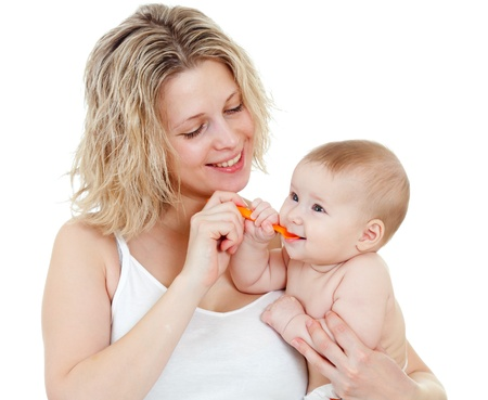 doses: baby eating with help of spoon Stock Photo