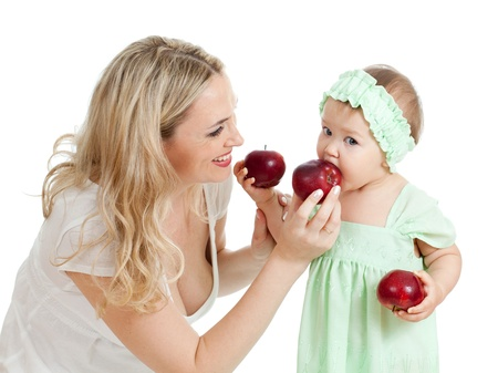 mother and her child with red apples photo