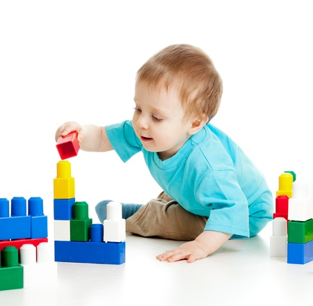 boys playing: little cheerful child with construction set over white background