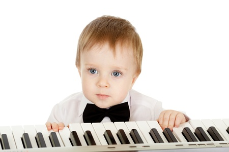 adorable child playing electronic piano photo