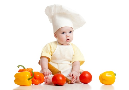 Portrait of a baby wearing a chef hat with healthy  food vegetables, isolated on white Stock Photo - 12075749