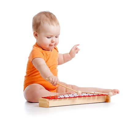 playing instrument: child playing with musical toy