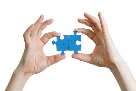 entreprise puzzle: casse-t�te dans les mains isol� sur blanc Banque d'images