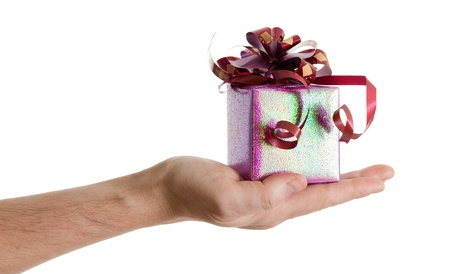 man hand with a small red gift box with ribbon isolated on white background photo