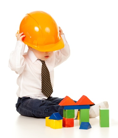 little boy with hard hat and building blocks Stock Photo - 12266141