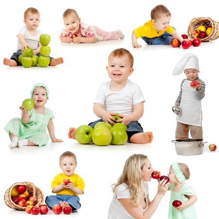 Cute children with healthy food apples. Isolated on white background. photo