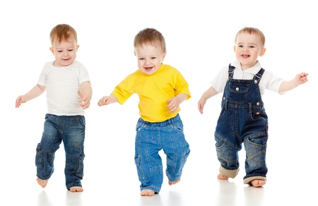 young boy smiling: Three little boys playing game and running