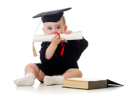 clever: Baby in academician clothes  with roll and book