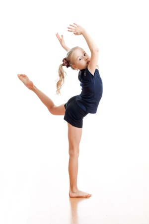 rhythmic gymnastics: young girl doing gymnastics over white background