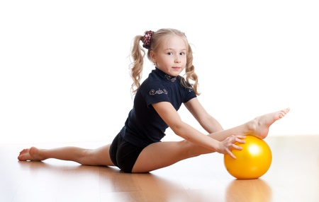 young gymnast: young girl doing gymnastics over white background