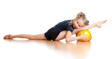 young girl doing gymnastics over white background photo