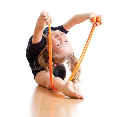 gymnastique: jeune fille faisant de la gymnastique sur fond blanc Banque d'images