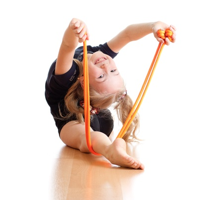 rhythmic gymnastics: joven haciendo gimnasia sobre fondo blanco