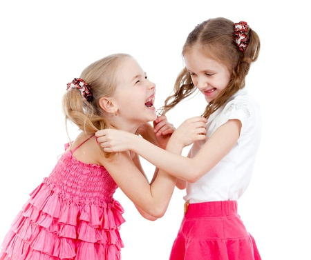 Two girls fighting over  white background photo