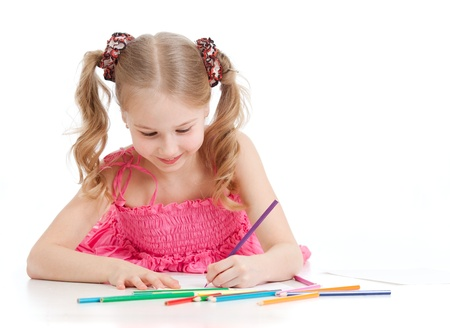 little girl surprised: happy girl drawing with pencils Stock Photo