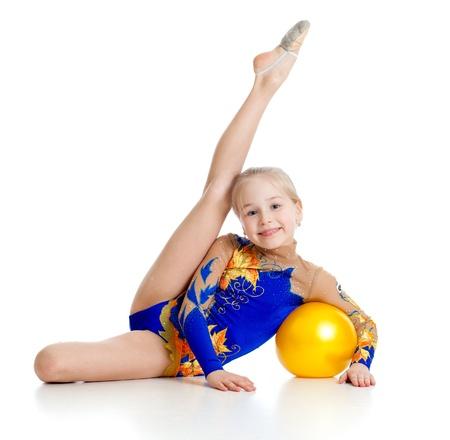 gymnastik: söt flicka gymnast med gul boll Stockfoto