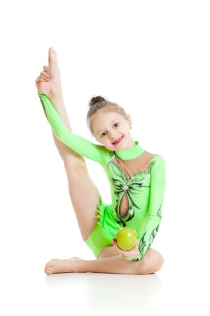 young girl gymnast with healthy food apple over white background photo