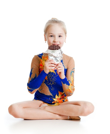 young girl  gymnast  with chocolate over white background photo