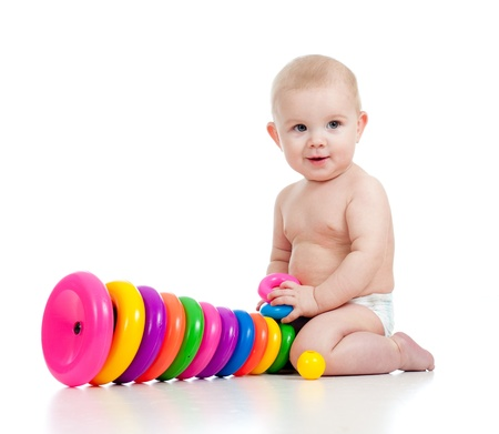 smiling child playing with color toy Stock Photo - 12266196