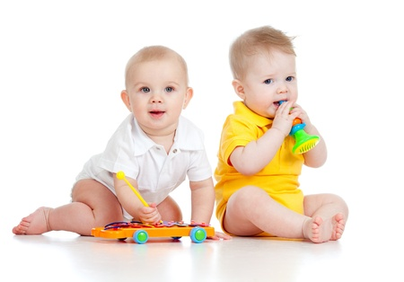 cute baby boy: Funny boy babies  with musical toys. Isolated on white background