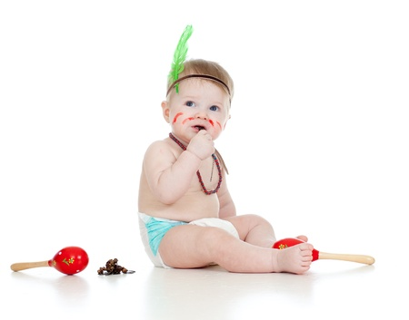 indian mask: funny boy baby  as indian  boy with maracas and feather Stock Photo