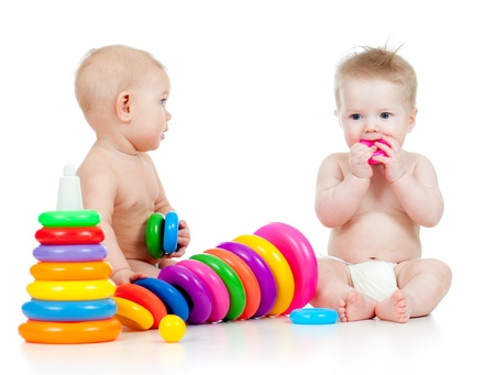 2 objects: children playing with color toys