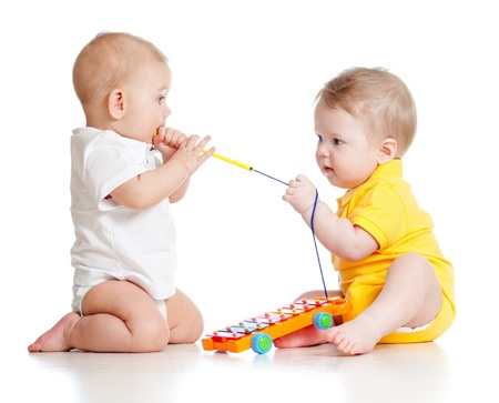 funny boys with musical toys photo