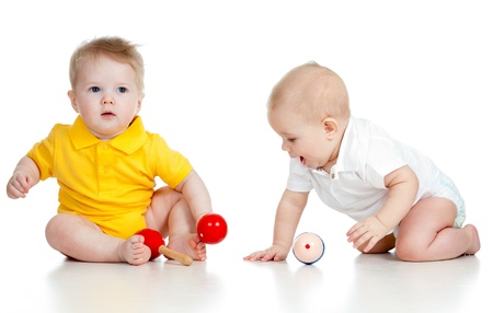 babies playing: Baby  boys with musical toys. Isolated on white background