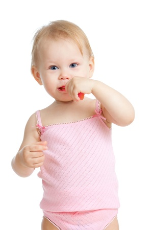 baby cleaning teeth and smiling, isolated on white background photo