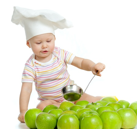 Adorable child with green apples photo