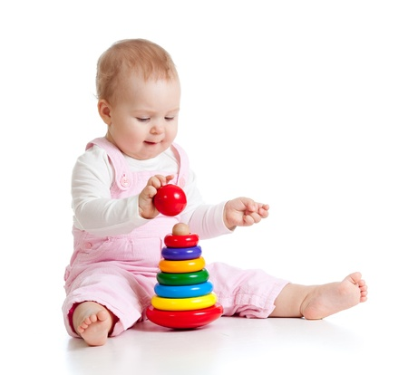 children playing with toys: child playing with color toy Stock Photo