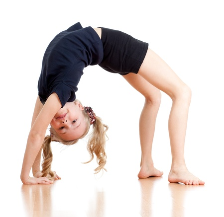 leotard: young girl doing gymnastics over white background