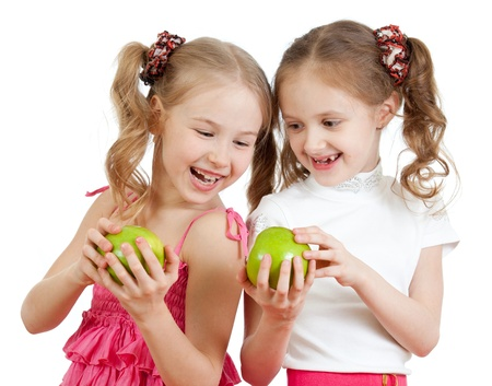two girls with green apple healthy food photo