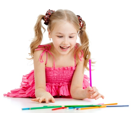 little girl surprised: happy pretty girl drawing with pencils Stock Photo