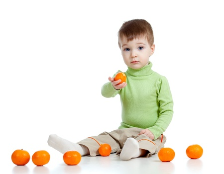 child offers fruits healthy food photo