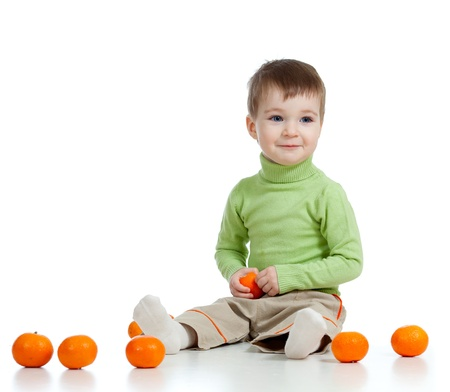 geen: smiling child with fruits Stock Photo