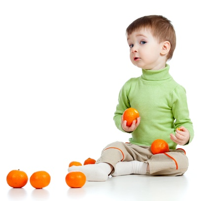 geen: funny child with fruits over white